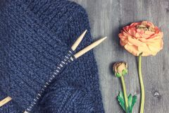 Knitted scarf of woolen blue thread stock photo