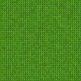 Knitted seamless green background Stock Images