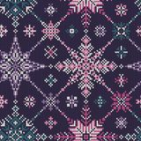 Knitted seamless multi-colored pattern of snowflakes Royalty Free Stock Photos