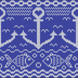 Knitted seamless pattern with anchors and fishes Royalty Free Stock Image