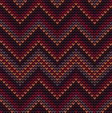 Knitted seamless pattern with colored frills. Decorative knitted seamless pattern with brown, orange, burgundy, purple and red triangular frills stock illustration