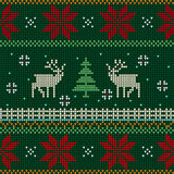 Knitted seamless pattern with deer Stock Photos