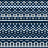 Knitted seamless pattern in Fair Isle style. Nordic traditional Fair Isle style seamless pattern on the wool knitted texture. EPS available Royalty Free Stock Photography