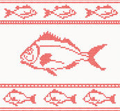 Knitted seamless pattern with fish Stock Photo