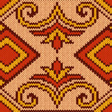 Knitted Seamless Pattern mainly in red and yellow Royalty Free Stock Photos