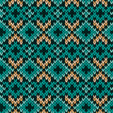 Knitted seamless pattern mainly in turquoise. Geometrical ornate knitted seamless vector pattern as a fabric texture in turquoise, green and beige hues Royalty Free Stock Photo