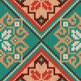 Knitted Seamless Pattern mainly in turquoise and red Stock Photos