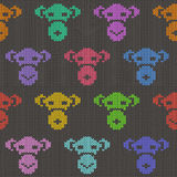 Knitted Seamless Pattern with Monkey Faces. Knitted seamless pattern with funny colorful monkey faces on a gray background vector illustration