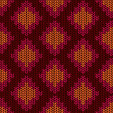 Knitted seamless pattern with rhombus Stock Images