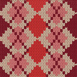 Knitted seamless pattern with rhombus Stock Photos