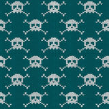 Knitted seamless pattern with skulls Stock Photo