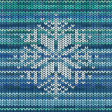 Knitted seamless pattern with snowflake Stock Image