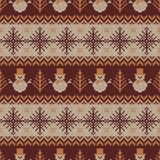 Knitted seamless pattern with snowmen and snowflakes. Knitted seamless pattern with snowmans and snowflakes. Brown, beige and white sweater background for Royalty Free Stock Photography