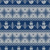 Knitted seamless pattern with snowmen and snowflakes. Knitted seamless pattern with snowmans and snowflakes. Blue and white sweater background for Christmas or Stock Image