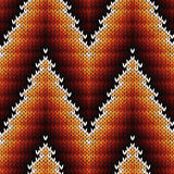 Knitted seamless pattern in warm hues Stock Photos