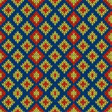 Knitted seamless symmetrical pattern. Knitted seamless symmetrical vector pattern with quadratic elements in blue, red and yellow colors as a fabric texture Royalty Free Stock Images