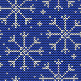 Knitted seamless winter pattern with snowflakes Royalty Free Stock Images