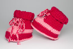 Knitted shoes for young children Royalty Free Stock Photos
