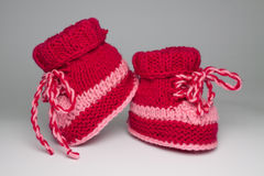 Knitted shoes for young children Stock Photos