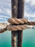 It is knitted on shrouds of classic sailing ships for climbing the mast. Clove Hitch Knot. It is knitted on shrouds of classic sailing ships for climbing the royalty free stock images
