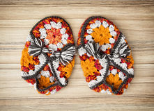 Knitted slippers with tassels Stock Photo