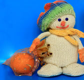 Knitted snowman. On a blue background Royalty Free Stock Image