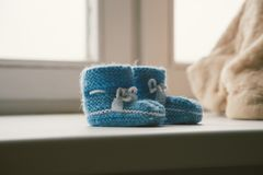 Knitted socks for babies stock image