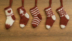 Knitted socks Christmas carols. Christmas carols knitted socks, decoration stock photos