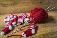 Knitted socks Christmas carols. Christmas carols knitted socks, yarn and needles stock images