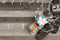 Knitted socks and Christmas gifts with Christmas ligh Royalty Free Stock Photography