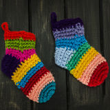 Knitted Socks. Colorful knitted socks on black wall Royalty Free Stock Photos