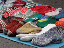 Knitted socks handmade on the market for sale. Selective focus Royalty Free Stock Photos