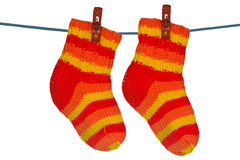 Knitted socks hung on the rope Royalty Free Stock Image