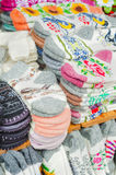 Knitted socks in the market Royalty Free Stock Photography