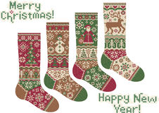 Knitted socks. Merry Christmas and New Year!. The complete set of socks for gifts. Knitted style. Christmas and New Year ornament Royalty Free Stock Photography