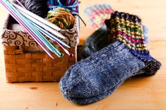 Knitted socks next two box with other accessories Stock Image