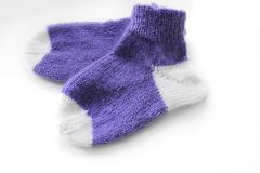 Knitted socks on a white background stock image