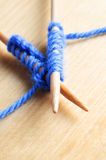 Knitted Stitches on Wooden Needles Stock Images