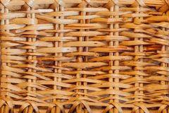 Knitted straw background or weaving pattern background in macro style. Weaving texture classic retro background for design.  stock photo