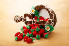Knitted strawberry in basket Stock Photos