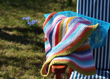 Knitted stripe blanket in a summer day Royalty Free Stock Image
