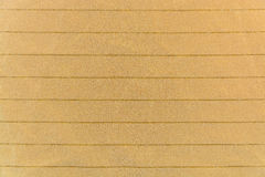 The knitted striped fabric ocher Royalty Free Stock Photos