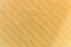 The knitted striped fabric ocher Royalty Free Stock Image