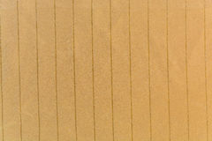 The knitted striped fabric ocher Stock Image
