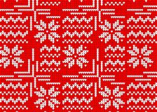 Knitted sweater winter pattern red, Norwegian style with a snowf. Lake Royalty Free Stock Photos