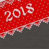 2018 knitted template. Christmas pattern knit. Card template with 2018 new year on red knitted fabric and dark wooden background. Flat vector cartoon Stock Photo