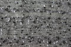 Knitted texture of boucle thread. The wavy texture of the fabric knit from yarn boucle Stock Images