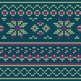 Knitted texture with floral pattern Stock Photo