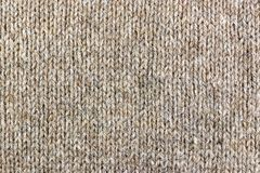 Knitted texture of lama wool closeup. Natural wool fabric background Royalty Free Stock Photo