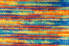Knitted texture. Knitted multicolored scarf. Texture or background Royalty Free Stock Photography